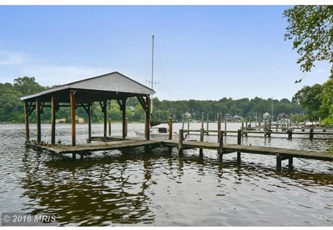 1 Acre w/ 230+ feet of riparian waterfront w/ sandy beach, pier, boat house & second slip on the Severn River. Renovate this home to grandeur with a $600,000 renovation budget. Select your finishes, bring your creativity & Award winning Lauer Homes w...