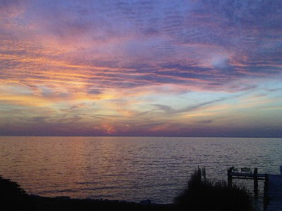 This wonderful waterfront retreat provides spectacular sunset views over the Chesapeake Bay. Enjoy and relax on the dock, by the pool or in the hot tub. If you have a boat, arrangements can be made to tie up at the Marina just one block away.