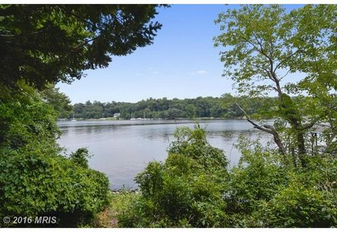 1 Acre with 230+ feet of riparian waterfront with sandy beach, pier, boat house and second slip on the Severn River. Exterior construction is granite block, renovate this home to grandeur! Great open concept floor plan with fire place and room sizes....