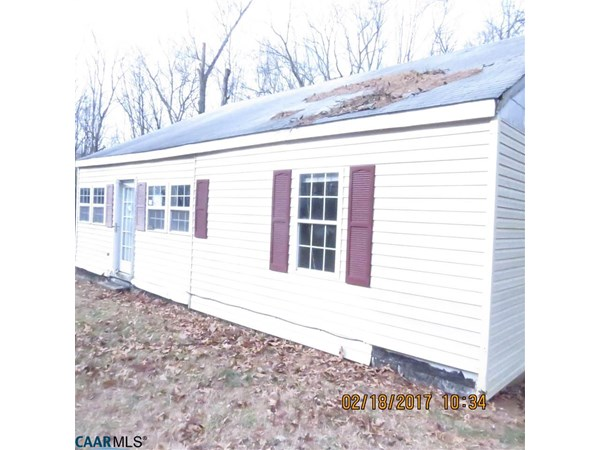 Corporate owned property-great rehab project-shared well is shared with 3 homes and they share the electric bill for the well pump. Shared driveway-full unfinished basement-good candidate for a rehab loan.