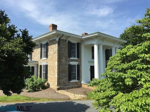 Neala, ca. 1840 was beautifully renovated in 1992. From stone gathered on the farm, this unique Greek Revival enjoys a private valley of 209 acres extending to the crest of Neal Mt. with great Blue Ridge views. Guest House