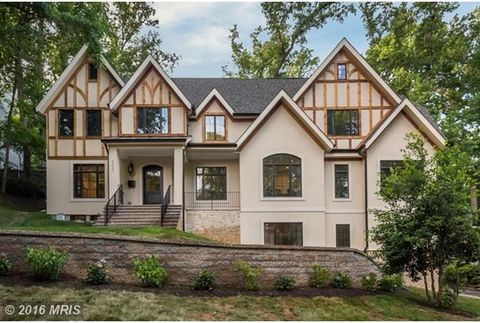 Majestic Tudor on a corner lot. Top to bottom renovated and expanded home offers 7 bedrooms 6&1/2 baths , fabulous gourmet kitchen & family room w/FP, finished lower level with wet bar and second family/game room w/FP plus a 2 car garage. hwd frs, hi...