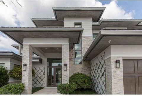 Contemporary/European style home located in the heart of Wellington. 4 bedrooms/6 bath