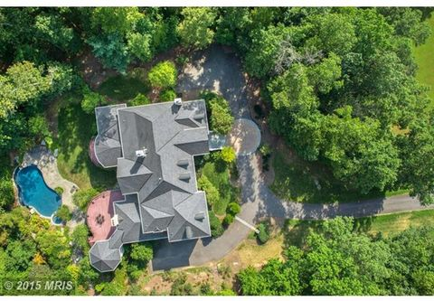 Newly Priced Luxury Estate Home in Oakton*Secluded Acreage Backing To Parkland*Incredible Views*Rich Hardwoods and Breathtaking Architectural Details*Truly A Work Of Art Inside and Out*Enjoy The Privacy While Being Within Minutes From All Amenities i...
