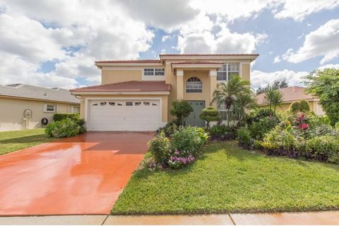 Quiet cul de sac in tranquil gated community off Aero Club Dr. in beautiful suburban Village of Wellington. This two story features 4 upstairs bedrooms and 2.5 baths with a picturesque privacy landscaped back yard with oversized ( 18'X34'') pool. Sou...