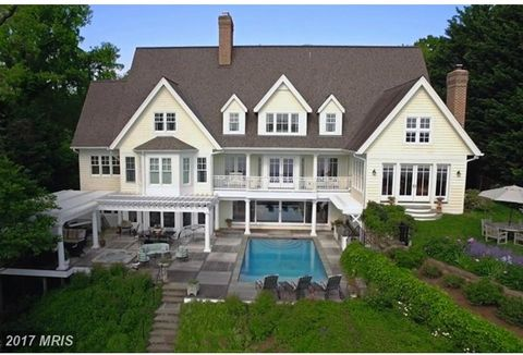 Elegant custom home w/ sweeping views of the Naval Academy &Severn River. Watch the Blue Angels by the waterside pool, hot tub, outdoor kitchen,&deep water pier w/3 lifts. No detail spared w/ lavish features throughout. Elevator, 4 fireplaces, gourme...