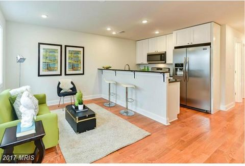 10K Closing Cost Credit if buyer chooses preferred lender. Sleek and modern in style, this new boutique condo building featuring four, fabulous homes with tons of natural light, soaring ceilings, gorgeous hardwood floors, recessed LED lighting, SS ap...
