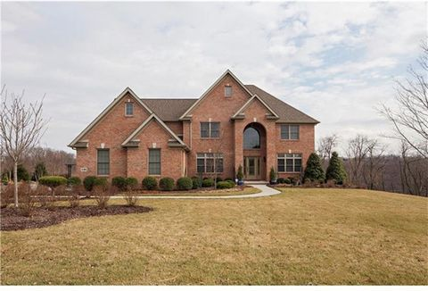 Custom brick home with 6000+sq ft of finished living space & is situated on 1.25+acre lot in one of Cranberry Township's most desirable neighborhoods.Enter this beauty from 2st arched brick entry & through the etched glass door with 2 etched side lig...