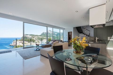 Stylish villa for sale in Port de Soller, frontline to the sea Modern, bright and stylish 3-storey villa, with superb views of Port de Soller. This house is composed of 3 bedrooms and 3 bathrooms, a large sitting room with an open plan kitchen, an en...