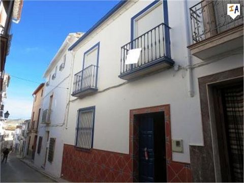 This is a large townhouse located in the centre of the popular town of Cuevas de San Marcos close to all the local amenities shops bars and restaurants. Entrance is via a beautifully tiled entrance hall which leads to a downstairs bedroom at the fron...