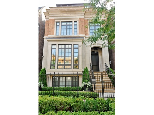 Stunning brick & limestone single family home on an extra wide lot. Boasting 6100Sq feet of functional living - custom millwork, crown molding, 4