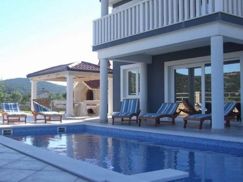 Opening to a furnished patio and balcony with Adriatic Sea, garden and pool views, the modernly furnished, air-conditioned Villa includes a spacious, fully equipped kitchen. The living room is fitted with a flat-screen TV and a dining table. A firepl...