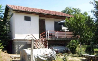 The property consists of a 2-story house offering about 108 sq.m. of living area, and a good-sized plot of land spreading over 900 sq.m. It is set in a green area near Stara Zagora and reveals forest views. The first floor of the house consists of a ...
