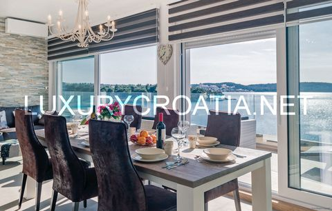 About this Property: Waterfront villa for sale, Trogir riviera (SE-T-V1) Waterfront villa for sale, Trogir riviera. Modern and stylish villa on a great location, first row to the sea. The closest beach is only about 20 meters away. The villa has beau...